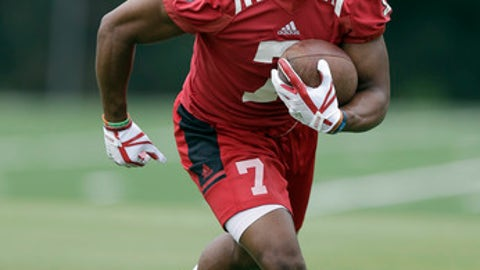 FILE - In this july 29, 2017, file photo, North Carolina State running back Nyheim Hines runs the ball during the team's NCAA college football practice in Raleigh, N.C. The junior is part of what coach Dave Doeren says will be a three-man rotation at running back for Saturday's opener against South Carolina. (AP Photo/Gerry Broome, File)