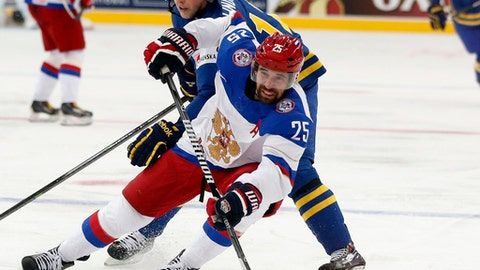 FILE - This May 24, 2014 file photo shows Russia forward Danis Zaripov, bottom, being challenged by Sweden forward Joakim Lindstrom during a semifinal match at the Ice Hockey World Championship in Minsk, Belarus. Zaripov has been cleared to pursue an NHL contract after being banned by the Kontinental Hockey League and International Ice Hockey Federation for doping. Agent Dan Milstein told The Associated Press on Monday, Aug. 28, 2017 that Zaripov was looking for a one-year deal so that he could prove himself. (AP Photo/Darko Bandic, file)