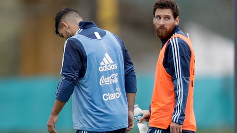 Argentina's Lionel Messi, right, and Sergio Aguero leave after a training session in preparation for an upcoming 2018 Russia World Cup qualifying soccer match against Uruguay, in Buenos Aires, Argentina, Monday, Aug. 28, 2017. (AP Photo/Natacha Pisarenko)