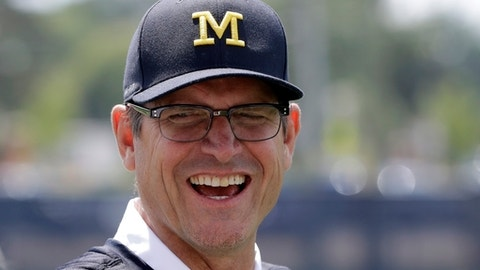 This July 17, 2017 photo shows Michigan football coach Jim Harbaugh in Ann Arbor, Mich. It's game week for Michigan, and Harbaugh is playing games of another kind — keeping his roster secret. He also won't say whether returning starter Wilton Speight or seldom-used senior John O'Korn will take the first snap for the 11th-ranked Wolverines against No. 17 Florida in Texas in the opener for both schools. (AP Photo/Carlos Osorio)