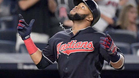 Cleveland Indians' Carlos Santana reacts as he comes home after hitting a home run against the New York Yankees during the seventh inning of a baseball game, Monday, Aug. 28, 2017, at Yankee Stadium in New York. (AP Photo/Bill Kostroun)
