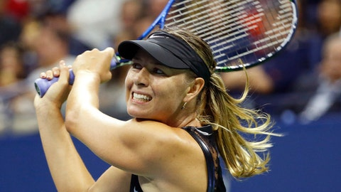Maria Sharapova, of Russia, follows through in her match against Simona Halep of Romania during her match in the opening round of the U.S. Open tennis tournament in New York, Monday, Aug. 28, 2017. (AP Photo/Kathy Willens)