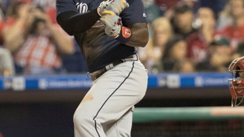 Atlanta Braves' Brandon Phillips singles to score Dansby Swanson during the sixth inning of a baseball game against the Philadelphia Phillies, Monday, Aug. 28, 2017, in Philadelphia. The Phillies won 6-1. (AP Photo/Chris Szagola)