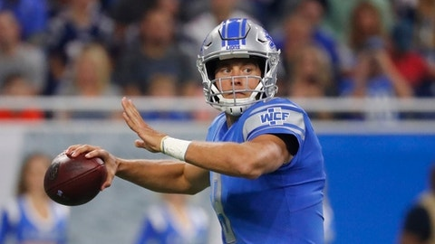 FILE - This Aug. 25, 2017 file photo shows Detroit Lions quarterback Matthew Stafford looking downfield during the first half of the team's NFL preseason football game against the New England Patriots in Detroit. Stafford has agreed to a five-year extension with the Lions. The team announced Monday, Aug. 28, 2017 the deal keeps the quarterback under contract through the 2022 season. (AP Photo/Rick Osentoski, file)