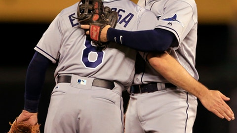 Tampa Bay Rays shortstop Danny Espinosa (8) celebrates with second baseman Brad Miller, right, following a baseball game against the Kansas City Royals at Kauffman Stadium in Kansas City, Mo., Monday, Aug. 28, 2017. The Rays defeated the Royals 12-0. (AP Photo/Orlin Wagner)