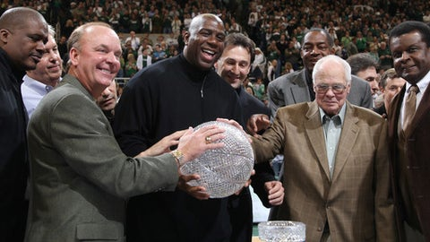 "Members of Michigan State's 1979 NCAA championship basketball team, including front row from left, Jay Vincent, Terry Donnelly, Earvin ""Magic"" Johnson, coach Jud Heathcote, and Gerald Gilkie, hold the championship trophy during a ceremony commemorating the 30th anniversary of the event, during halftime of an NCAA college basketball game between Michigan State and Wisconsin, Sunday, Feb. 22, 2009, in East Lansing, Mich. Michigan State won Sunday's game 61-50. (AP Photo/Al Goldis)"