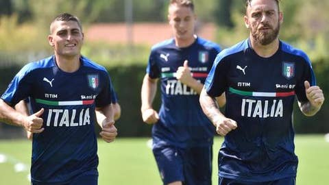 Italy's players Marco Veratti, left, and Daniele De Rossi, right, jog during a training session at the Coverciano Sports Center near Florence, Italy, Tuesday, Aug. 29, 2017. Italy is scheduled to play Spain in a 2018 World Cup qualifying soccer match in Madrid on Sept. 2. (Maurizio degl'Innocenti/ANSA via AP)