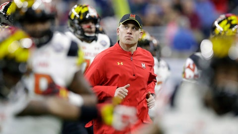 FILE - In this Monday, Dec. 26, 2016 file photo, Maryland head coach DJ Durkin runs onto the field before the Quick Lane Bowl NCAA college football game against Boston College in Detroit. There were several reasons why Tyrrell Pigrome won the starting quarterback job at Maryland, not the least of which are experience, running ability and leadership skills. Coach DJ Durkin took all that under consideration, then decided that the 5-foot-11 sophomore should be the one to lead the offense against No. 23 Texas in season opener on Saturday, Sept. 2, 2017. (AP Photo/Carlos Osorio, File)