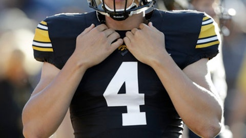 FILE - In this Sept. 10, 2016, file photo, Iowa quarterback Nathan Stanley warms up before an NCAA college football game against Iowa State in Iowa City, Iowa. Iowa quarterback Nathan Stanley is such a mystery that few knew until Tuesday, Aug. 29, 2017 that he actually likes to be called Nate because when he hears Nathan, he assumes his mom is mad at him. (AP Photo/Charlie Neibergall, File)