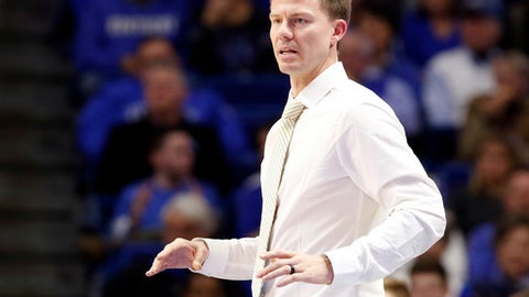 Valparaiso head coach Matt Lottich reacts to a play during the second half of an NCAA college basketball game against Kentucky, Wednesday, Dec. 7, 2016, in Lexington, Ky. Kentucky won 87-63.(AP Photo/James Crisp)