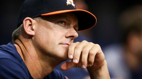 Houston Astros manager A.J. Hinch watches from the dugout in the first inning of the team's baseball game against the Texas Rangers in St. Petersburg, Fla., Tuesday, Aug. 29, 2017. (Will Vragovic/The Tampa Bay Times via AP)
