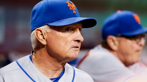 New York Mets manager Terry Collins watches from the dugout during the fifth inning of the team's baseball game against the Cincinnati Reds, Tuesday, Aug. 29, 2017, in Cincinnati. (AP Photo/John Minchillo)