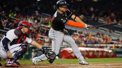 Miami Marlins' Giancarlo Stanton strikes out to Washington Nationals starting pitcher Edwin Jackson during the third inning of a baseball game at Nationals Park, Tuesday, Aug. 29, 2017, in Washington. Behind the plate is Nationals catcher Matt Wieters. (AP Photo/Pablo Martinez Monsivais)