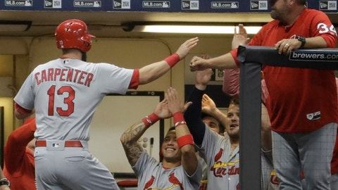 St. Louis Cardinals' Matt Carpenter is congratulated after hitting a two-run home run during the fifth inning of a baseball game against the Milwaukee Brewers Tuesday, Aug. 29, 2017, in Milwaukee. (AP Photo/Morry Gash)