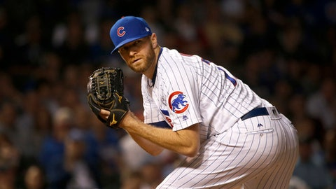 Chicago Cubs relief pitcher Wade Davis checks the runner at first during the ninth inning of a baseball game against the Pittsburgh Pirates Tuesday, Aug. 29, 2017, in Chicago. The Cubs won 4-1. (AP Photo/Charles Rex Arbogast)