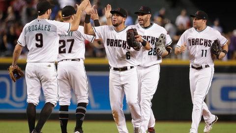 The Arizona Diamondbacks' celebrate after a baseball game against the Los Angeles Dodgers, Tuesday, Aug. 29, 2017, in Phoenix. The Diamondbacks won 7-6. (AP Photo/Matt York)