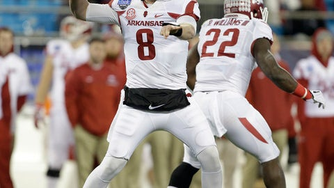 FILE - In this Dec. 29, 2016, file photo, Arkansas's Austin Allen (8) passes against Virginia Tech as teammate Rawleigh Williams III waits for someone to block during the first half of the Belk Bowl NCAA college football game in Charlotte, N.C. After an offseason marked by the frustration of two epic second-half meltdown losses to close last season, Arkansas becomes the first Southeastern Conference team to open the season when it travels to Little Rock to face Florida A&M on Thursday night. (AP Photo/Bob Leverone, File)
