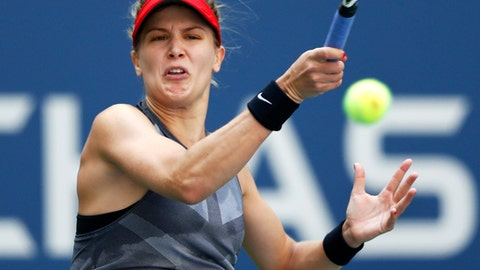 Eugenie Bouchard, of Canada, returns a shot from Evgeniya Rodina, of Russia, during the first round of the U.S. Open tennis tournament, Wednesday, Aug. 30, 2017, in New York. (AP Photo/Adam Hunger)