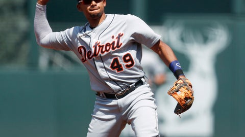 Detroit Tigers second baseman Dixon Machado throws to first base to put out Colorado Rockies' Gerardo Parra to end the first inning of a baseball game Wednesday, Aug. 30, 2017, in Denver. (AP Photo/David Zalubowski)