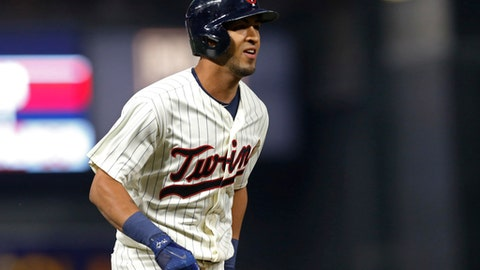 Minnesota Twins' Eddie Rosario jogs home on a two-run home run off Chicago White Sox pitcher Derek Holland during the third inning of a baseball game Wednesday, Aug. 30, 2017, in Minneapolis. (AP Photo/Jim Mone)