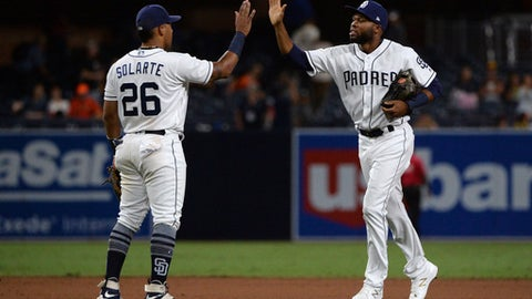 San Diego Padres' Yangervis Solarte and Manuel Margot celebrate the team's 5-0 victory over the San Francisco Giants in a baseball game Wednesday, Aug. 30, 2017, in San Diego. (AP Photo/Orlando Ramirez)