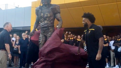 In this Aug. 30, 2017, image made from video, a bronze statue of Pat Tillman is unveiled during a ceremony at Sun Devil Stadium in Tempe, Ariz. Tillman played football at Arizona State from 1994 to 1997 and went on to play for the NFL's Arizona Cardinals. Tillman became an Army Ranger in 2003 and was killed by friendly fire in Afghanistan in 2004. (AP Photo)