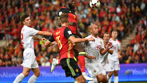 Belgium's Romelu Lukaku, center, fights for control of the ball against Gibraltar's Jason Pusey, third right, during a World Cup 2018 Group H qualifying soccer match between Belgium and Gibraltar at the Sclessin Stadium in Liege, Belgium, Thursday, Aug. 31, 2017. (AP Photo/Geert Vanden Wijngaert)