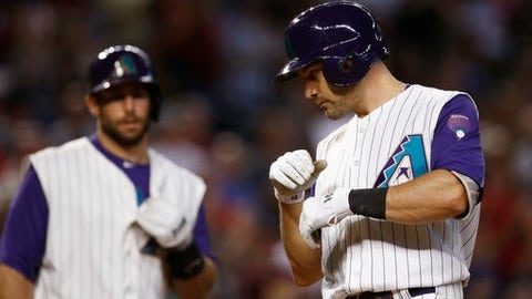 Arizona Diamondbacks' A.J. Pollock, right, arrives at home plate after hitting a two-run home run against the Los Angeles Dodgers as teammate Paul Goldschmidt, left, looks on during the third inning of a baseball game Thursday, Aug. 31, 2017, in Phoenix. (AP Photo/Ross D. Franklin)