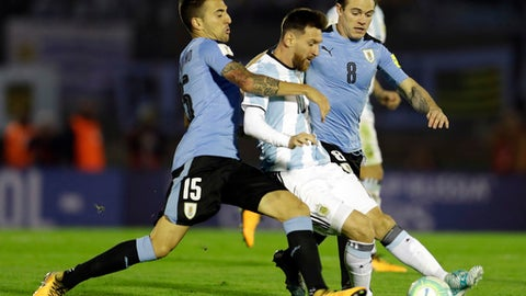 Argentina's Lionel Messi fights for the ball with Uruguay's Matias Vecino during a 2018 World Cup qualifying soccer match in Montevideo, Uruguay, Thursday, Aug. 31, 2017.(AP Photo/Natacha Pisarenko)