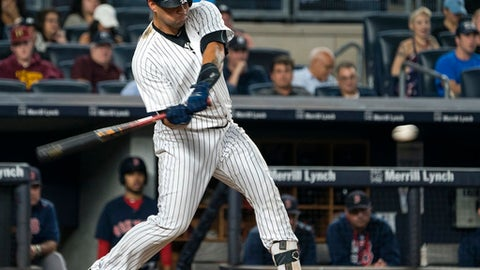 New York Yankees' Gary Sanchez swings for a home run against the Boston Red Sox during the third of a baseball game Thursday, Aug. 31, 2017, in New York. (AP Photo/Craig Ruttle)