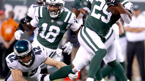 New York Jets running back Bilal Powell (29) avoids a tackle by Philadelphia Eagles free safety Chris Maragos (42) during the first half of an NFL football game, Thursday, Aug. 31, 2017, in East Rutherford, N.J. (AP Photo/Michael Noble Jr.)
