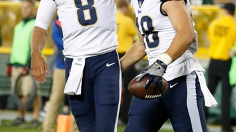 Los Angeles Rams quarterback Dan Orlovsky congratulates Johnny Mundt after a touchdown catch during the second half of a preseason NFL football game against the Green Bay Packers Thursday, Aug. 31, 2017, in Green Bay, Wis. (AP Photo/Matt Ludtke)
