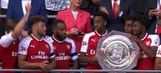 Arsenal celebrate with Community Shield trophy after win over rival Chelsea