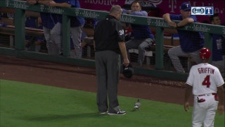 Jeff Banister helps an injured bird off the field