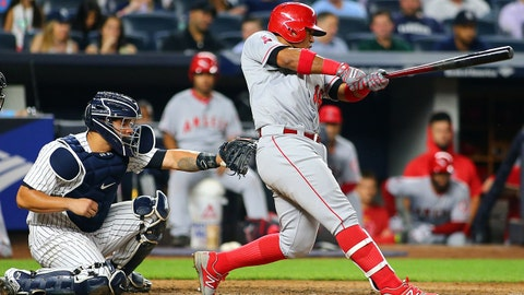 Jun 22, 2017; Bronx, NY, USA; Los Angeles Angels first baseman Luis Valbuena (18) hits an RBI single against the New York Yankees during the sixth inning at Yankee Stadium. Mandatory Credit: Andy Marlin-USA TODAY Sports