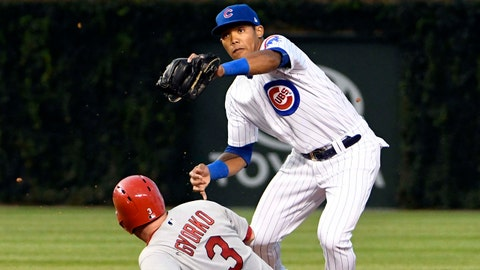 Jul 23, 2017; Chicago, IL, USA; Chicago Cubs shortstop Addison Russell (27) forces out St. Louis Cardinals third baseman Jedd Gyorko (3) during the fourth inning at Wrigley Field. Mandatory Credit: David Banks-USA TODAY Sports