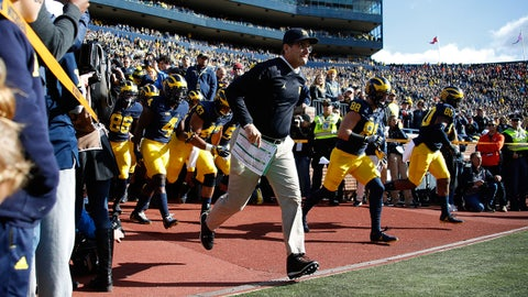 ANN ARBOR, MI - OCTOBER 22: Head coach Jim Harbaugh of the Michigan Wolverines leads the team onto the field to play the Illinois Fighting Illini on October 22, 2016 at Michigan Stadium in Ann Arbor, Michigan. (Photo by Gregory Shamus/Getty Images)