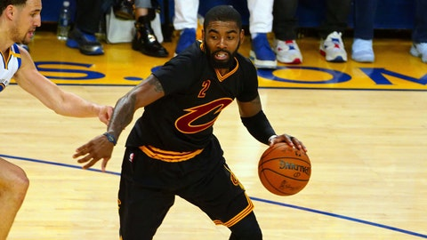 Jun 12, 2017; Oakland, CA, USA; Cleveland Cavaliers guard Kyrie Irving (2) handles the ball against Golden State Warriors guard Stephen Curry (30) during the third quarter in game five of the 2017 NBA Finals at Oracle Arena. Mandatory Credit: Kelley L Cox-USA TODAY Sports