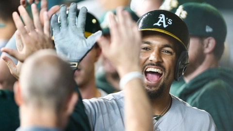 Aug 20, 2017; Houston, TX, USA; Oakland Athletics shortstop Marcus Semien (10) celebrates in the dugout after scoring a run during the first inning against the Houston Astros at Minute Maid Park. Mandatory Credit: Troy Taormina-USA TODAY Sports