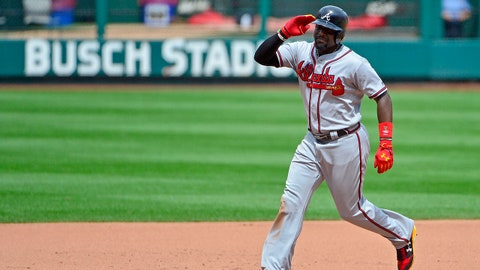 Aug 13, 2017; St. Louis, MO, USA; Atlanta Braves third baseman Brandon Phillips (4) salutes the St. Louis Cardinals fans after hitting a two run home run off of starting pitcher Michael Wacha (not pictured) during the fifth inning at Busch Stadium. Mandatory Credit: Jeff Curry-USA TODAY Sports