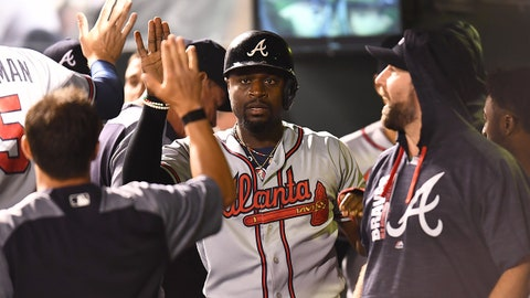 Aug 15, 2017; Denver, CO, USA; Atlanta Braves second baseman Brandon Phillips (4) celebrates scoring the go ahead run in the eighth inning against the Colorado Rockies at Coors Field. Mandatory Credit: Ron Chenoy-USA TODAY Sports