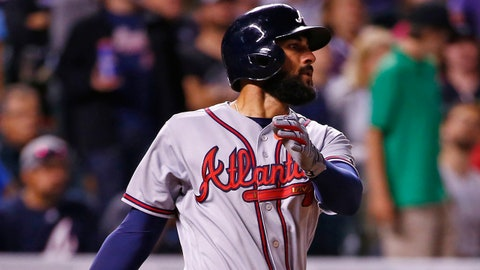 Atlanta Braves' Nick Markakis watches the flight of a solo home run ball hit off Colorado Rockies starting pitcher Kyle Freeland during the sixth inning of a baseball game Tuesday, Aug. 15, 2017, in Denver. (AP Photo/Jack Dempsey)