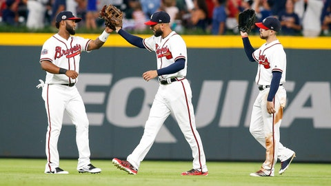Aug 4, 2017; Atlanta, GA, USA; Atlanta Braves left fielder Danny Santana (23) and right fielder Nick Markakis (22) and center fielder Ender Inciarte (11) celebrate a victory against the Miami Marlins at SunTrust Park. Mandatory Credit: Brett Davis-USA TODAY Sports