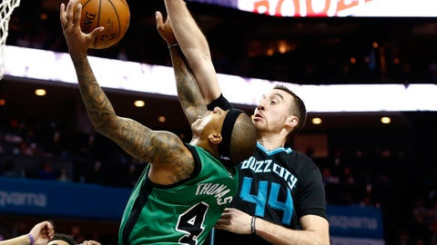 Apr 8, 2017; Charlotte, NC, USA; Boston Celtics guard Isaiah Thomas (4) goes up for a shot against Charlotte Hornets center Frank Kaminsky (44) during the second half at Spectrum Center. The Celtics defeated the Hornets 121-114. Mandatory Credit: Jeremy Brevard-USA TODAY Sports