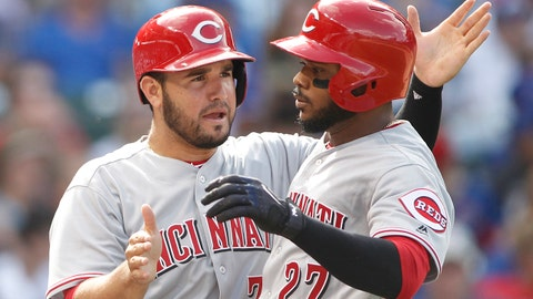 Aug 17, 2017; Chicago, IL, USA; Cincinnati Reds right fielder Phillip Ervin (27) celebrates with third baseman Eugenio Suarez (7) after hitting a 2-run home run during the seventh inning against the Chicago Cubs at Wrigley Field. Mandatory Credit: Caylor Arnold-USA TODAY Sports
