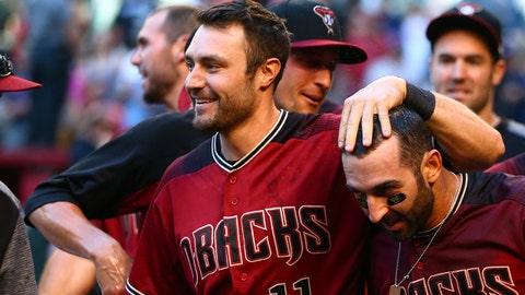 Apr 30, 2017; Phoenix, AZ, USA; Arizona Diamondbacks second baseman Daniel Descalso (right) celebrates with teammate A.J. Pollock after hitting a walk off home run in the thirteenth inning against the Colorado Rockies at Chase Field. Mandatory Credit: Mark J. Rebilas-USA TODAY Sports
