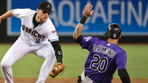 Jun 30, 2017; Phoenix, AZ, USA; Colorado Rockies left fielder Ian Desmond (20) steals second base on Arizona Diamondbacks second baseman Brandon Drury (27) in the first inning at Chase Field. Mandatory Credit: Matt Kartozian-USA TODAY Sports
