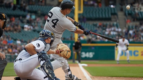 Aug 23, 2017; Detroit, MI, USA; New York Yankees catcher Gary Sanchez (24) hits a home run in the first inning against the Detroit Tigers at Comerica Park. Mandatory Credit: Rick Osentoski-USA TODAY Sports