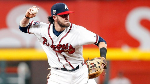 Jun 22, 2017; Atlanta, GA, USA; Atlanta Braves shortstop Dansby Swanson (7) throws a runner out at first against the San Francisco Giants in the fourth inning at SunTrust Park. Mandatory Credit: Brett Davis-USA TODAY Sports