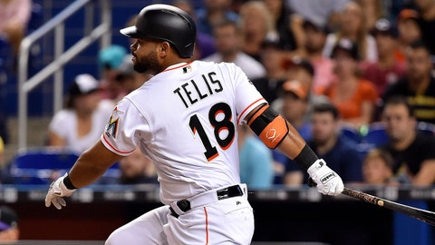 Aug 11, 2017; Miami, FL, USA; Miami Marlins first baseman Tomas Telis (18) hits a single in the fifth inning against the Colorado Rockies at Marlins Park. Mandatory Credit: Steve Mitchell-USA TODAY Sports